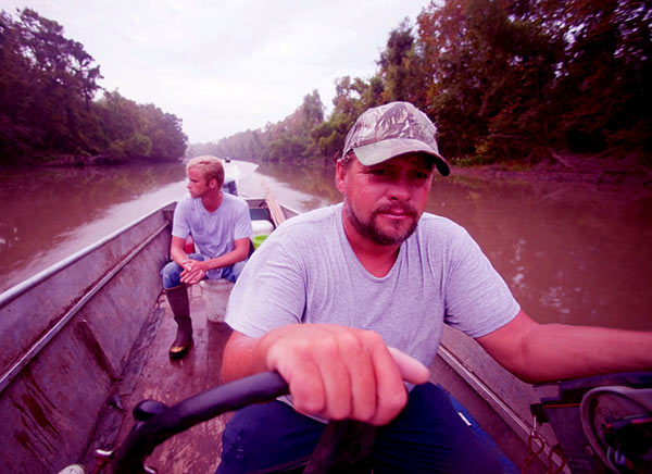 Image of Caption: Junior and his son Willie on Swamp people