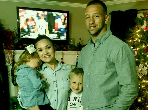 Image of Caption: Jay Paul with his wife Ashleigh Price along with their two kids